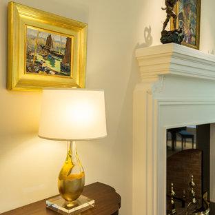 ニューヨークの広いトランジショナルスタイルのおしゃれな独立型リビング (フォーマル、ベージュの壁、濃色無垢フローリング、標準型暖炉、木材の暖炉まわり、テレビなし、茶色い床) の写真