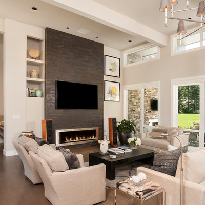 Example of a trendy formal and open concept dark wood floor and brown floor living room design in Seattle with beige walls, a ribbon fireplace, a tile fireplace and a wall-mounted tv