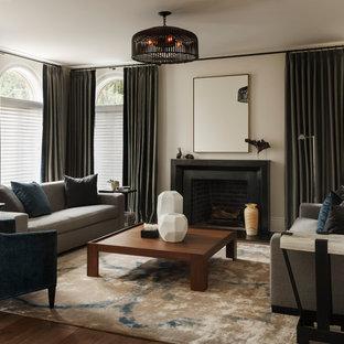 Esempio di un ampio soggiorno chic aperto con sala formale, pareti beige, pavimento in legno massello medio, camino classico, cornice del camino in pietra e nessuna TV