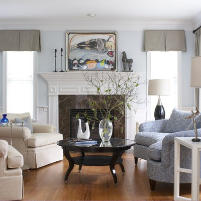 Elegant living room photo in Bridgeport with blue walls and a standard fireplace