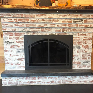 Medium sized rustic formal enclosed living room in Philadelphia with a standard fireplace, a brick fireplace surround, brown walls, concrete flooring, no tv and black floors.