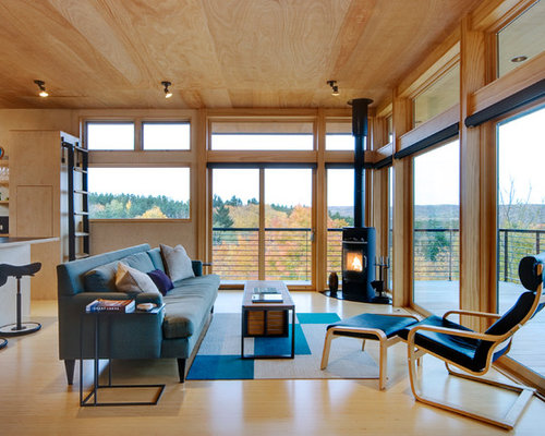 example of a midsized trendy open concept and formal light wood floor living room