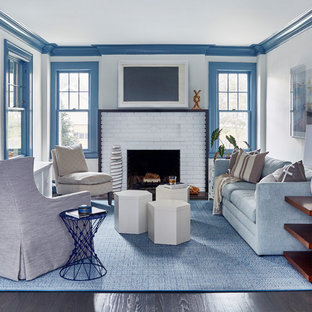 Inspiration for a large beach style formal and enclosed dark wood floor and brown floor living room remodel in New York with white walls, a standard fireplace, a brick fireplace and no tv