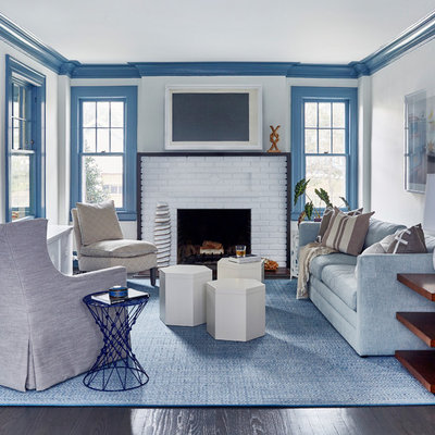 Inspiration for a large coastal formal and enclosed dark wood floor and brown floor living room remodel in New York with white walls, a standard fireplace, a brick fireplace and no tv