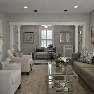 This is an example of a medium sized classic formal enclosed living room in New York with grey walls, dark hardwood flooring, a standard fireplace, no tv and a stone fireplace surround.