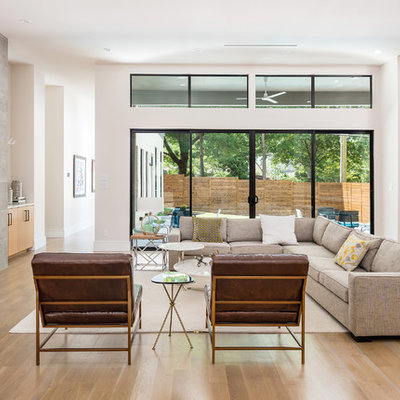 Large trendy open concept light wood floor and beige floor living room photo in Dallas with white walls, a ribbon fireplace, a tile fireplace and a wall-mounted tv
