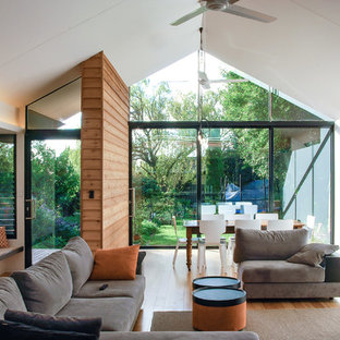 Mid-sized contemporary open concept living room in Adelaide with a library, white walls, bamboo floors, a standard fireplace, a metal fireplace surround and beige floor.