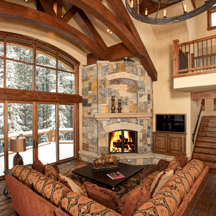 Inspiration for a contemporary living room in Denver with a corner fireplace.