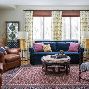 Inspiration for a medium sized world-inspired living room in Boston with grey walls, no fireplace, no tv and medium hardwood flooring.