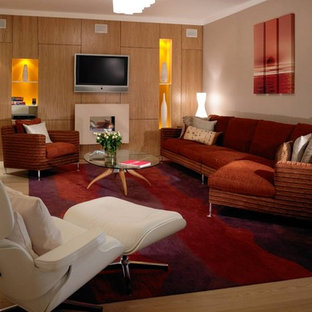 Design ideas for a contemporary enclosed living room in London with a wall mounted tv.