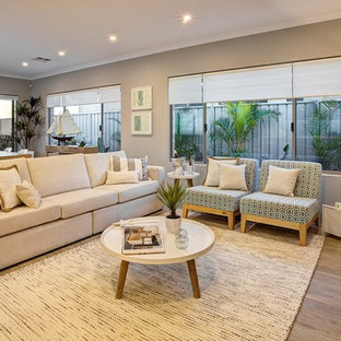 Example of a mid-sized coastal open concept and formal light wood floor living room design in Perth with beige walls
