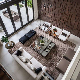 Huge trendy open concept porcelain floor and gray floor living room photo in Miami with gray walls, no fireplace and no tv