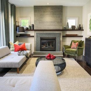 トロントの中サイズのコンテンポラリースタイルのおしゃれなLDK (濃色無垢フローリング、標準型暖炉、グレーの壁、石材の暖炉まわり) の写真