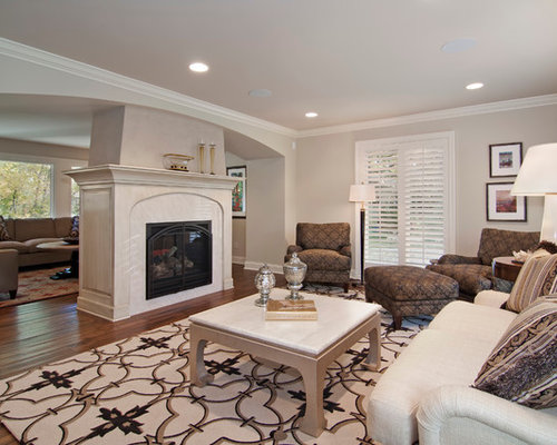 Center room fireplace home design ideas pictures remodel for House plans with fireplace in center of house