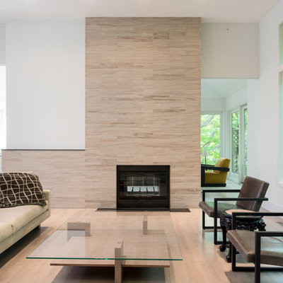 Inspiration for a mid-sized scandinavian formal and enclosed light wood floor living room remodel in Minneapolis with white walls, a standard fireplace, no tv and a tile fireplace