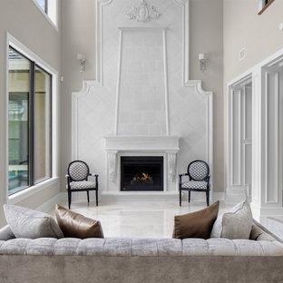 Idee per un grande soggiorno tradizionale aperto con sala formale, pareti beige, pavimento in marmo, camino classico, cornice del camino in legno e nessuna TV