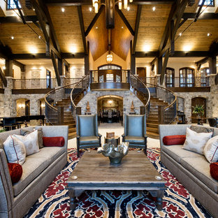 デンバーの巨大なラスティックスタイルのおしゃれなLDK (フォーマル、壁掛け型テレビ、白い壁、ライムストーンの床、標準型暖炉、石材の暖炉まわり、白い床) の写真