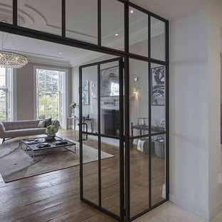 Inspiration for a contemporary enclosed living room in Hertfordshire with medium hardwood flooring.