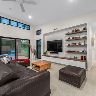 Photo of a contemporary formal open concept living room in Brisbane with white walls, concrete floors, a wall-mounted tv and beige floor.