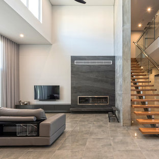 Contemporary formal open concept living room in Sydney with white walls, concrete floors, a ribbon fireplace, a wall-mounted tv and grey floor.