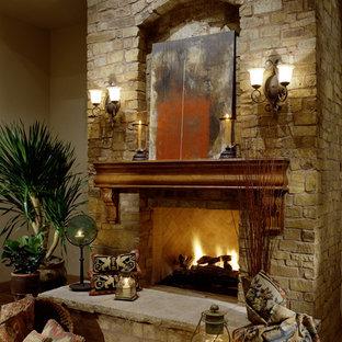 フェニックスの巨大な地中海スタイルのおしゃれなLDK (フォーマル、ベージュの壁、トラバーチンの床、標準型暖炉、石材の暖炉まわり) の写真
