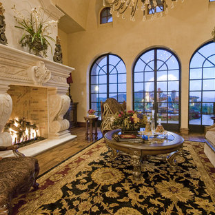Inspiration for a huge mediterranean formal and open concept travertine floor living room remodel in Phoenix with beige walls, a standard fireplace and a stone fireplace