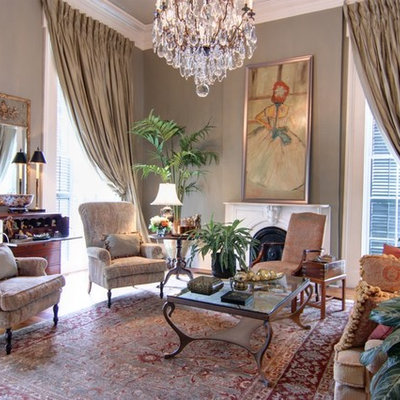 Mid-sized elegant formal and open concept dark wood floor living room photo in New Orleans with gray walls, a standard fireplace, a plaster fireplace and no tv