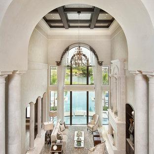 Idee per un ampio soggiorno tradizionale aperto con sala formale, pareti beige, pavimento in marmo, camino classico e cornice del camino in pietra