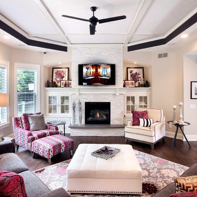 Mid-sized transitional open concept and formal medium tone wood floor living room photo in Grand Rapids with beige walls, a standard fireplace, a wall-mounted tv and a stone fireplace