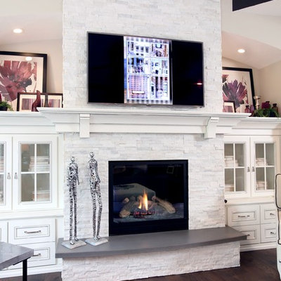 Living room - mid-sized transitional open concept medium tone wood floor living room idea in Grand Rapids with beige walls, a standard fireplace, a tile fireplace and a wall-mounted tv