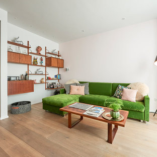 Photo of a contemporary open plan living room in London with white walls, medium hardwood flooring and beige floors.