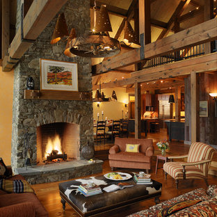Inspiration for a rustic living room in Burlington with a stone fireplace surround.