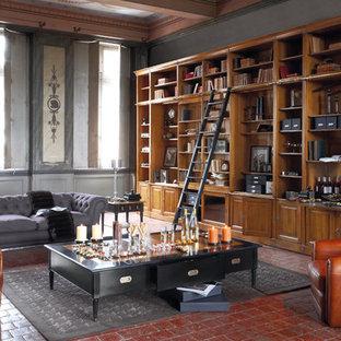 Idee per un soggiorno contemporaneo di medie dimensioni e aperto con libreria, pareti grigie, pavimento con piastrelle in ceramica, nessun camino, cornice del camino in pietra, parete attrezzata e pavimento rosso