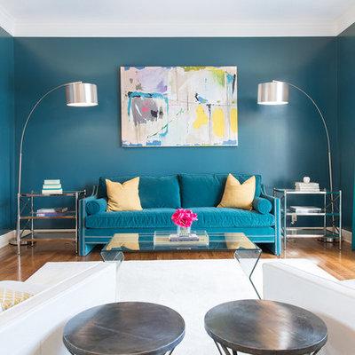 Mid-sized trendy medium tone wood floor living room photo in Kansas City with green walls