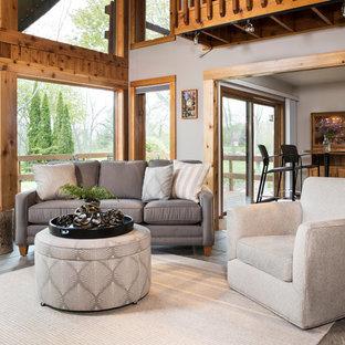 Foto di un soggiorno rustico di medie dimensioni e aperto con sala formale, pareti grigie, pavimento in ardesia, nessun camino, nessuna TV e pavimento blu