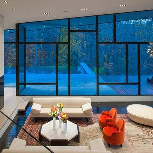 Foto di un ampio soggiorno contemporaneo aperto con sala formale e camino lineare Ribbon