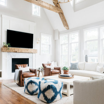 Living room - transitional medium tone wood floor and brown floor living room idea in Chicago with gray walls, a standard fireplace, a stone fireplace and a wall-mounted tv