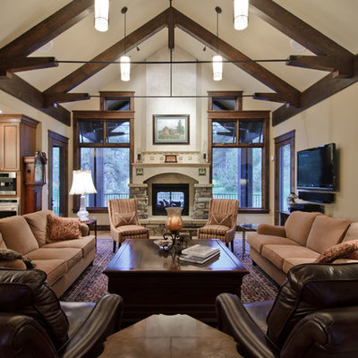 Living room - traditional living room idea in Denver with a stone fireplace