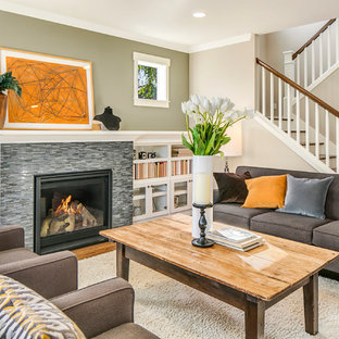 Transitional open concept medium tone wood floor living room photo in Seattle with beige walls, a standard fireplace and a stone fireplace