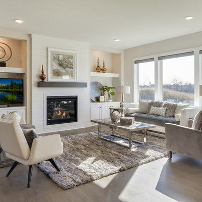 Transitional open concept dark wood floor and brown floor living room photo in Minneapolis with beige walls, a standard fireplace, a tv stand and a wood fireplace surround