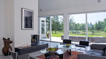 Great Room in Contemporary European Farmhouse Featuring Lift and Slide Doors