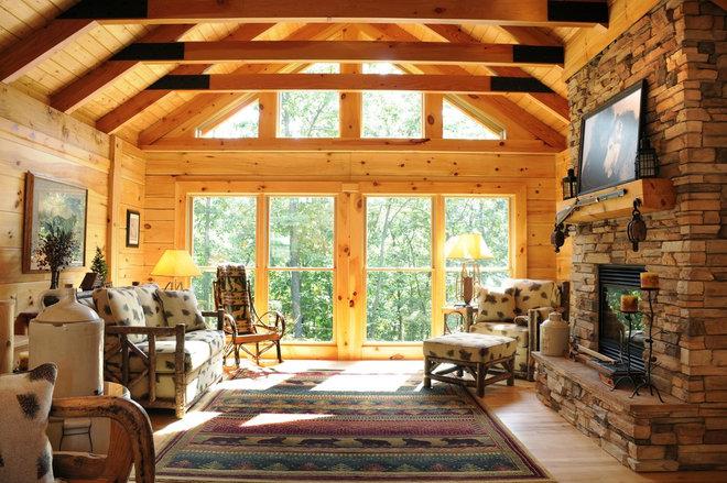 Rustic Living Room by JG Development, Inc.