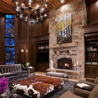Living room - huge traditional formal and open concept limestone floor and beige floor living room idea in Minneapolis with brown walls, a standard fireplace, a stone fireplace and a media wall