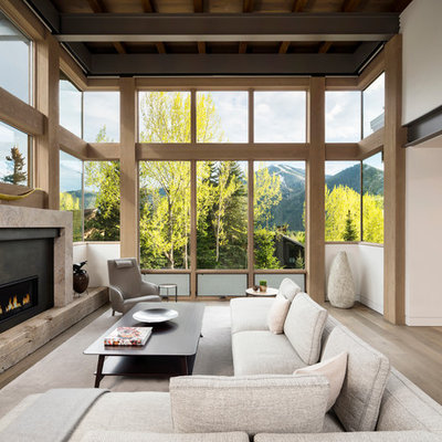 Example of a large mountain style formal and open concept light wood floor living room design in Salt Lake City with white walls, a ribbon fireplace, a metal fireplace and no tv