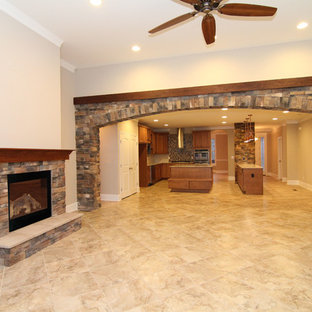 Huge transitional open concept ceramic floor living room photo in Raleigh with a bar, beige walls, a standard fireplace, a stone fireplace and a wall-mounted tv