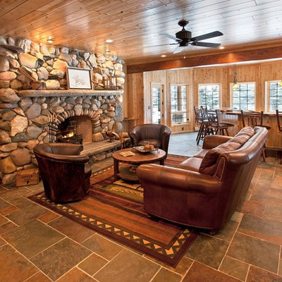 Example of a mountain style open concept living room design in Detroit with a standard fireplace and a stone fireplace