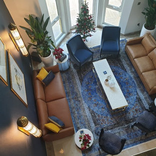 Large trendy formal and open concept ceramic floor living room photo in Other with blue walls