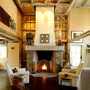 Example of a mountain style living room design in Boston with a stone fireplace
