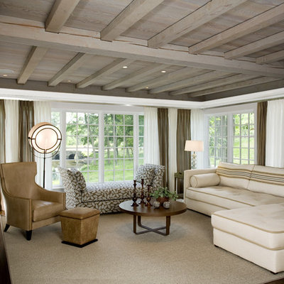 Inspiration for a large contemporary enclosed dark wood floor and brown floor living room remodel in New York with white walls, a wall-mounted tv and no fireplace