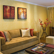 Modern Living Room by Decorating Den Interiors